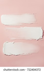 image of cream smear. pink  background
