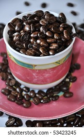 an image of cup filled with coffee beans