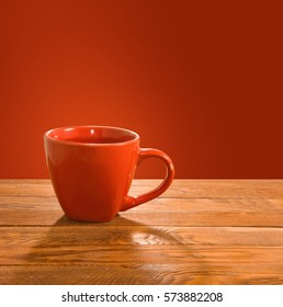 image of cup on wooden table closeup