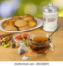 image of cup of tea, buns, cakes and sweets