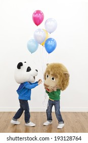 the image of cute Asian kids with bear masks and balloons