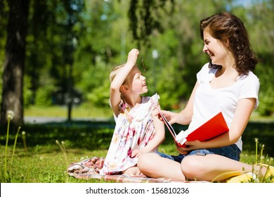 Image of cute girl and her mother playing in park