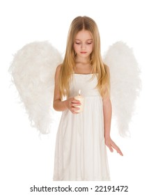 Image of cute girl with white wings behind and lit candle in hands