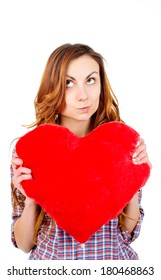 an image of cute woman holding a toy heart