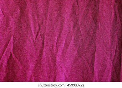 image of dark pink creased fabric