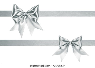An image of a decorative satin silver ribbon two bows with ribbons by frame  isolated on white background