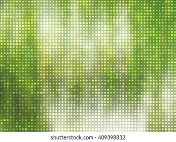 Image of defocused stadium lights.  Abstract green background.