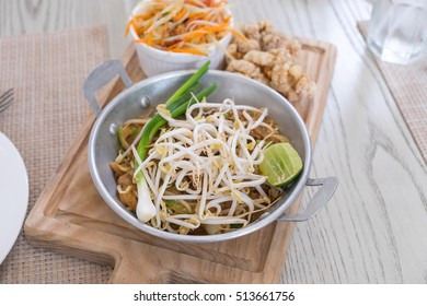 Image of delicious hot and spicy Thai papaya salad or somtam and fried noodle or pad Thai, popular local dish for food background