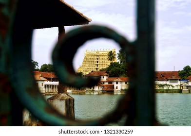 Image depicting the gopuram of the Lord Vishnu temple of Padmanabhaswamy along with the temple pond located at the city center of Trivandrum located in the Indian state of Kerala