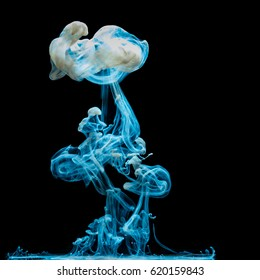 Image depicting the growing, moving, spreading cloud of a simple, colored drop of milk in suspension in water.