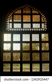 The image depicts the motif work on a window inside a tomb in Gwalior, Madhya Pradesh, India. The image was captured just before sunset.
