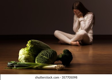 Image of despair woman suffering from eating disorder