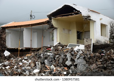 Image of a destroyed building in a city after a land slide
