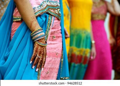 Image detail shot of henna tattoo and saris