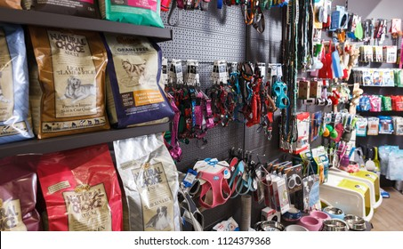 Image of different variation of goods for animals in pet shop