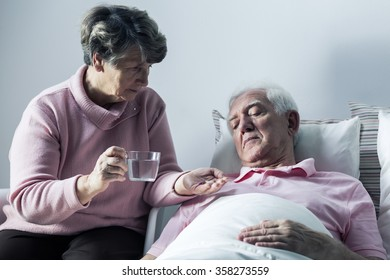 Image of disabled senior man and his caring wife