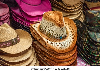 127a37f87f6c37 An image of a display of ladies cowboy hats arranged in neat stacks on a  floral