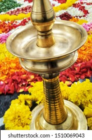 A image of Diya Brass Stand for Puja Celebrations for any festive occasions such as Onam, Diwali or any Hindu festival with colorful flower background.