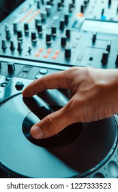 image of Dj playing music at mixer closeup