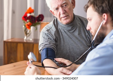 Image of doctor and senior with hypertension