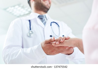 Image of doctor and senior patient hands