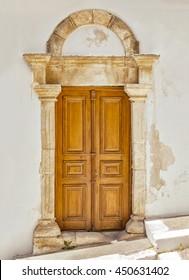 Image of a door with limestone pillars. Crete, Greece.