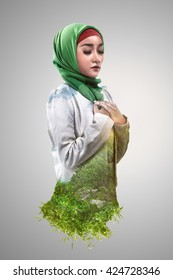 Image of double exposure muslim woman with green grass and blue sky