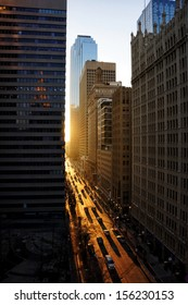 an image of downtown buildings at dusk