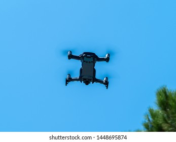Image of a drone under the blue sky in full flight