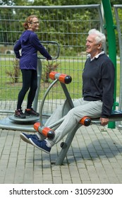 Image of elder people spending leisure time in outdoor gym