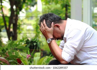 Image of elderly stressed man facepalm or cover his face by hands.4os or 50s man depressed,or may suffering from headaches and migraine as of Menopause in men,get trouble in his life