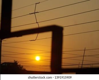 Image of electric wires as seen through verandah railing.