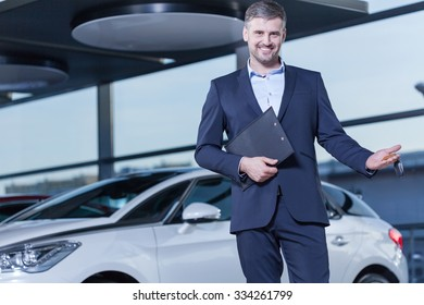 Image of elegant car buyer with keys and documents