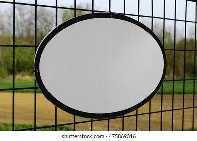 Image of an empty board on a fence