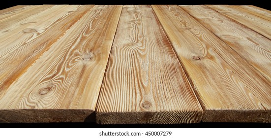 Image of empty bumpy wooden table top closeup