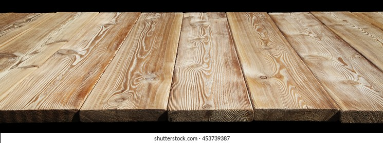 Image of empty bumpy wooden table top