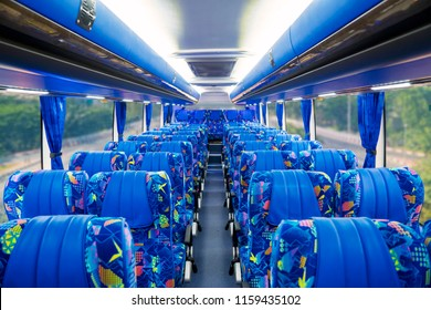 Image of empty passenger seats with blue leather in the tour bus
