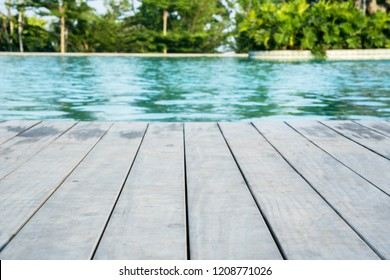 Image of empty swimming pool with poolside wooden deck