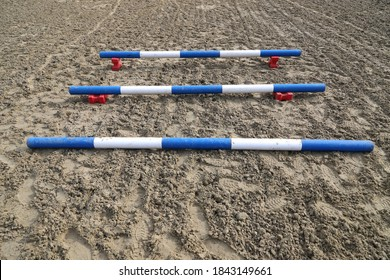 Image of an empty training field. Barriers for schooling horses as a background. Colorful photo of equestrian obstacles. Empty field for horse training event