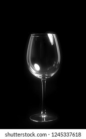 An image of an empty wine glass on black background