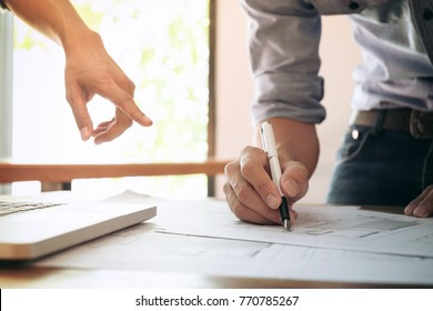 Image of engineer or architectural project, engineering and partner drawing plan on BluePrint with Engineering tools on workplace.
