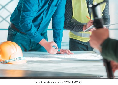 Image of engineer meeting for architectural project. working with partner and engineering tools on workplace vintage tone