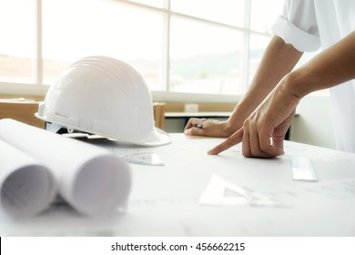 Image of engineer meeting for architectural project, working with partner and engineering tools on workplace vintage tone. Construction concept.