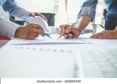Image of engineer meeting for architectural project. working with partner and engineering tools on workplace