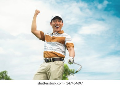 Image of an excited golf player viewed below