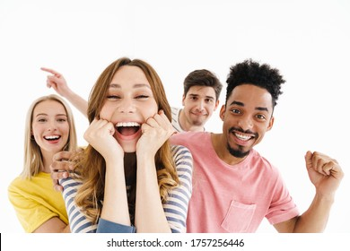 Image of excited multinational men and women smiling and expressing surprise on camera isolated over white background