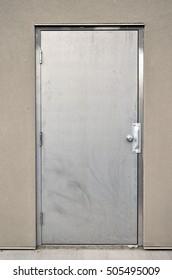 An image of an exterior steel industrial door.