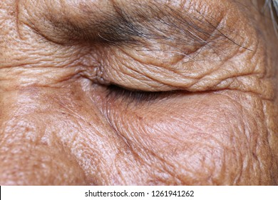 image eyes closed of elderly woman the left eye side, extreme close-up shot eyes close of elderly woman asia and wrinkles skin around the eyes (selective focus)
