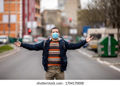 The image face of a young man wearing a mask to prevent germs, toxic fumes, and dust. Prevention of bacterial infection Corona virus or Covid 19 in the air around the streets and gardens.