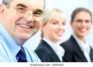 Image of faces of business people with boss in front